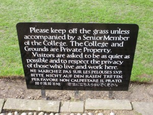 'Keep off the grass unless accompanied' sign